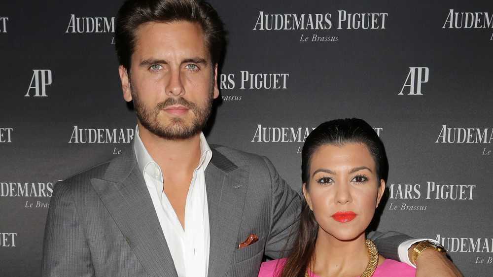 MIAMI BEACH, FL - SEPTEMBER 27: Scott Disick and Kourtney Kardashian attend a cocktail reception to celebrate the launch of new watch for Audemars Piguet on September 27, 2013 in Miami Beach, Florida. (Photo by Alexander Tamargo/Getty Images)